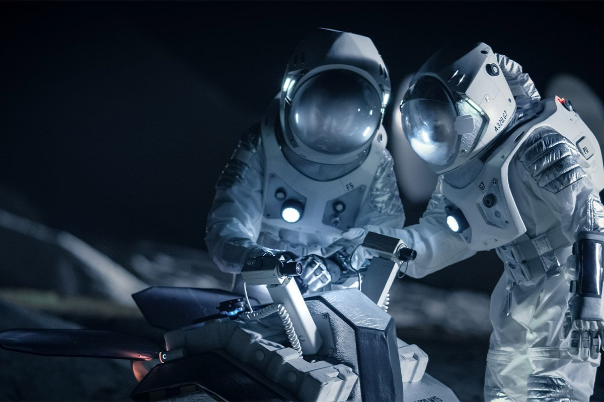 Astronauts working together in space